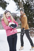 Teenage Couple Having Snowball Fight In Snowy Landscape — Stock Photo