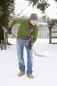 Young Man Clearing Snow From Drive — Stok fotoğraf