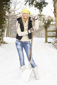 Teenage Girl Clearing Snow From Drive — 图库照片