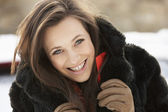 Close Up Of Teenage Girl Wearing Fur Coat In Snowy Landscape — Foto Stock
