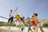 Group Of Teenage Friends Playing Volleyball On Beach — Stock Photo