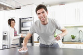 Young Couple Cleaning Cleaning Modern Kitchen — Stock Photo