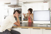 Young Couple Discussing Personal Finances In Modern Kitchen — Stock Photo
