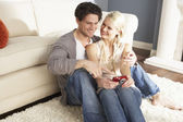Couple Taking Photograph On Digital Camera At Home — Stock Photo