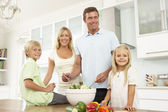 Family Preparing Salad In — Stock Photo