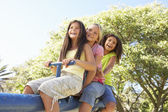 Girls Riding On See Saw — Stock Photo