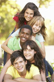 Group Of Teenagers Piled Up In Park — Foto Stock