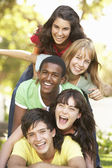 Group Of Teenagers Piled Up In Park — Stock Photo