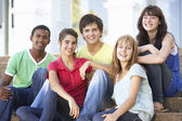 Group Of Teenage Friends Sitting On College Steps Outside — Stock Photo