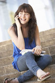 Teenage Student Sitting Outside On College Steps — Stockfoto
