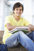 Male Teenage Student Sitting Outside On College Steps — Stock Photo