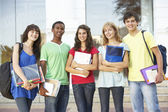 Group Of Teenage Students Standing Outside College Building — Foto Stock