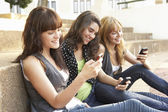 Group Of Teenage Students Sitting Outside On College Steps Using — Stock Photo