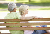 Senior Couple Sitting Together On Park Bench — Stock Photo