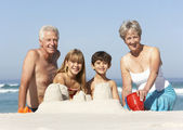 Family Building Sandcastles On — Stock Photo