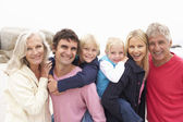 Close Up Of Three Generation Family On Winter Beach — Stock Photo
