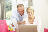 Couple Using Laptop At Home — Stock Photo
