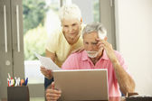 Worried Senior Couple Using Laptop At Home — Stock Photo
