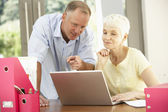 Adult Son And Senior Mother Using Laptop At Home — Stock Photo
