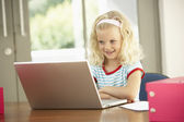 Young Girl Using Laptop At Home — Stok fotoğraf