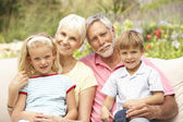 Grandparents And Grandchildren Relaxing In Garden — Stock Photo