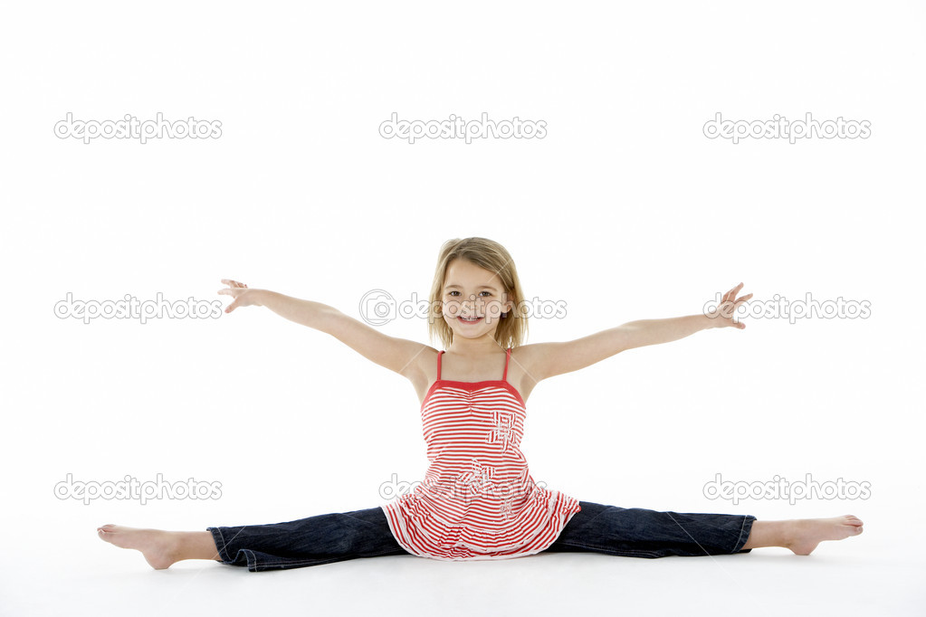 Young Girl In Gymnastic Pose Doing Splits - Stock Image