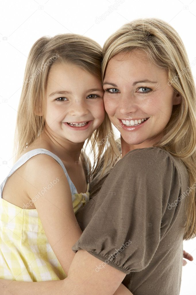 Studio Portrait Of Mother Hugging Young Daughter — Stock Photo #4835436