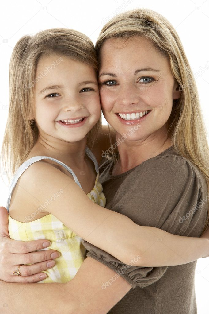 Studio Portrait Of Mother Hugging Young Daughter  Stock Photo #4835439