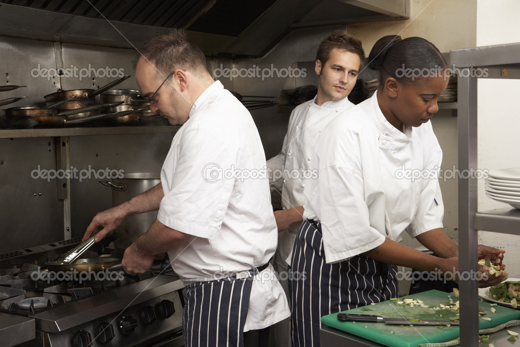 Team Of Chefs Preparing Food In Restaurant Kitchen — Stock Photo #4835938