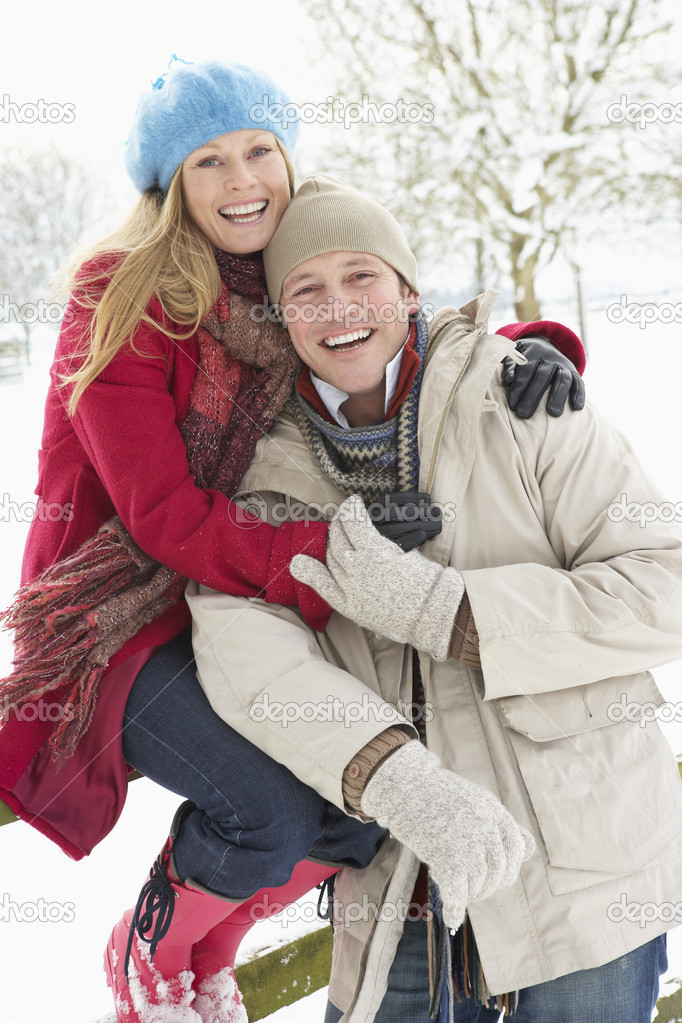Couple Standing Outside In Snowy Landscape — Stock Photo #4836201