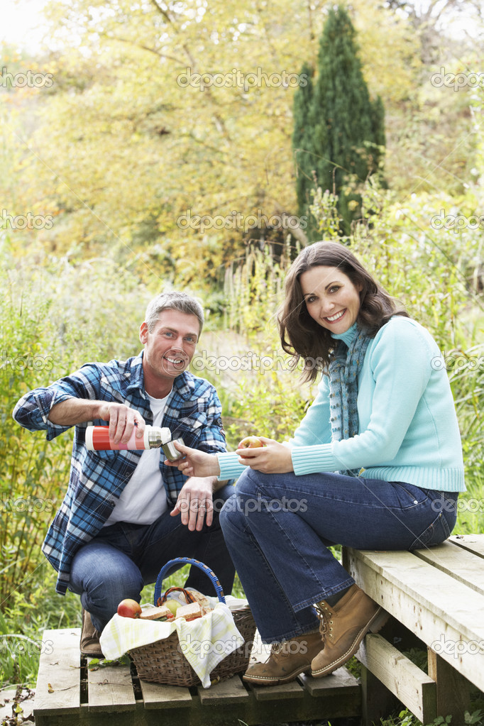 Couple Enjoying Picnic Outdoors In Autumn Woodland — Stock Photo #4836354
