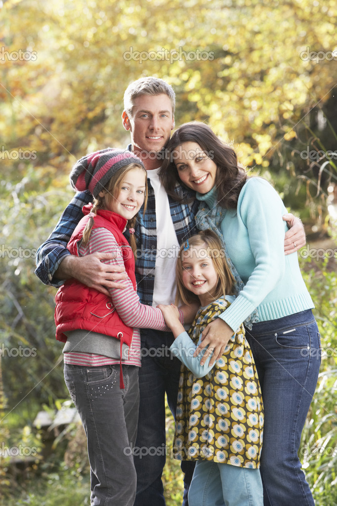 Family Group Standing Outdoors On Wooden Walkway In Autumn Lands — Стоковая фотография #4836365