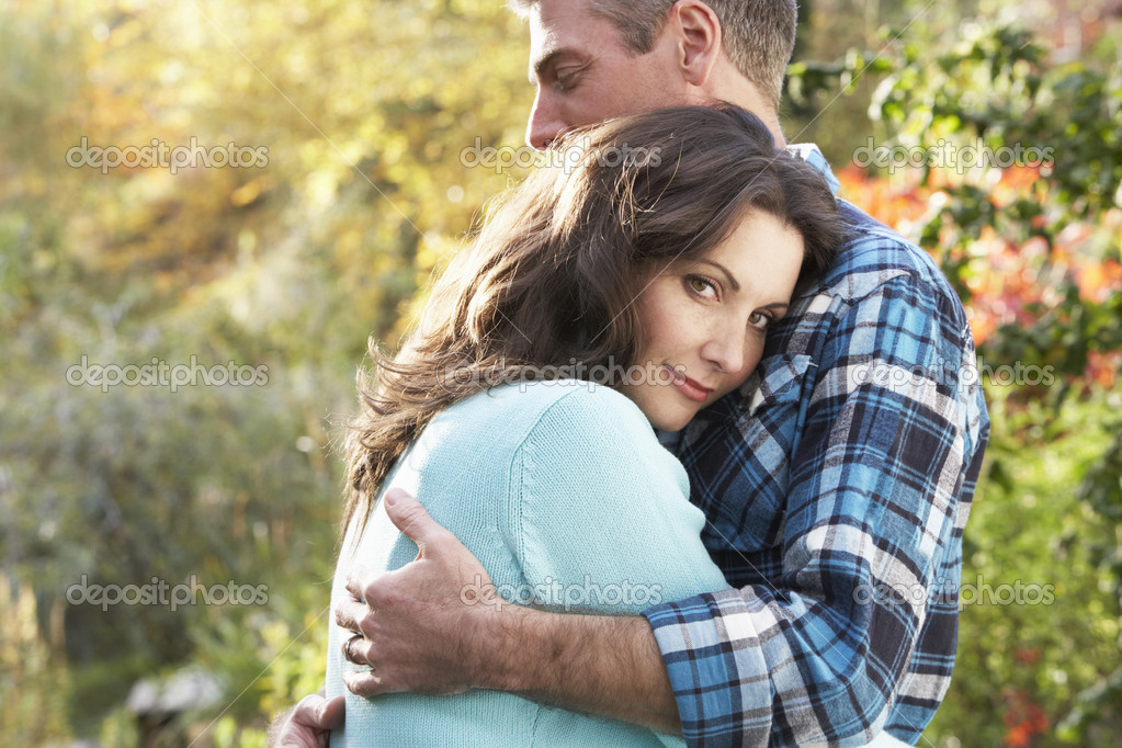 Close Up Of Romantic Couple Embracing By Autumn Woodland — Stock Photo #4836383