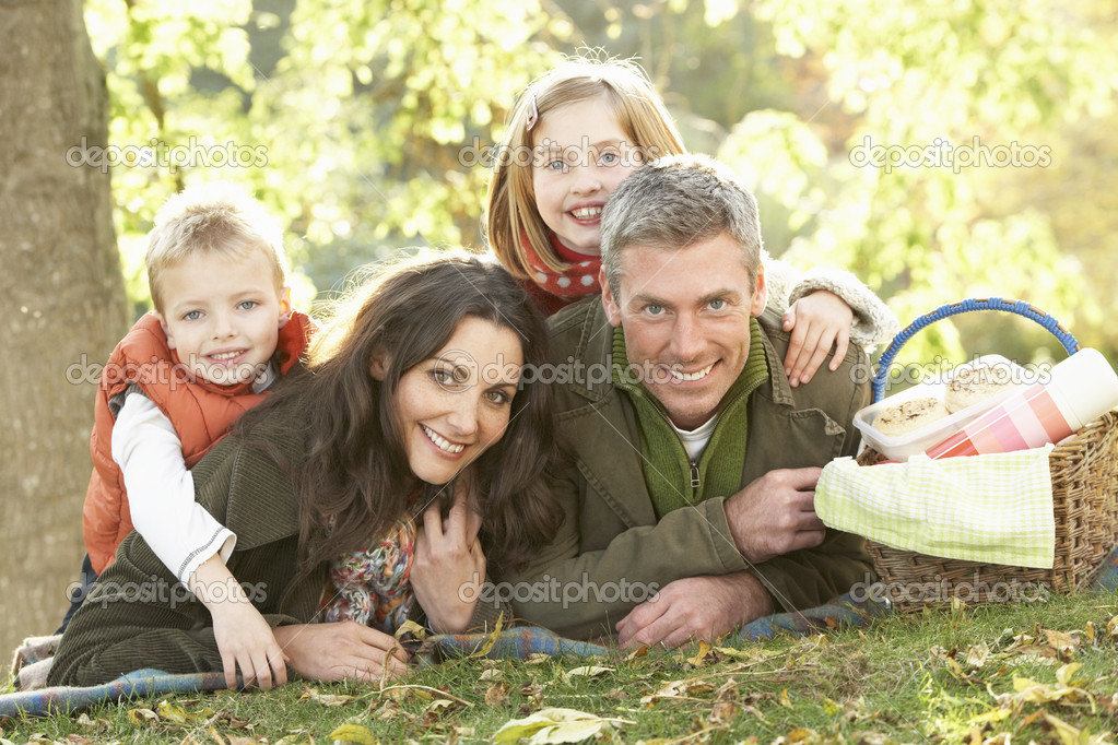 Family Group Relaxing Outdoors In Autumn Landscape  Stock Photo #4836404