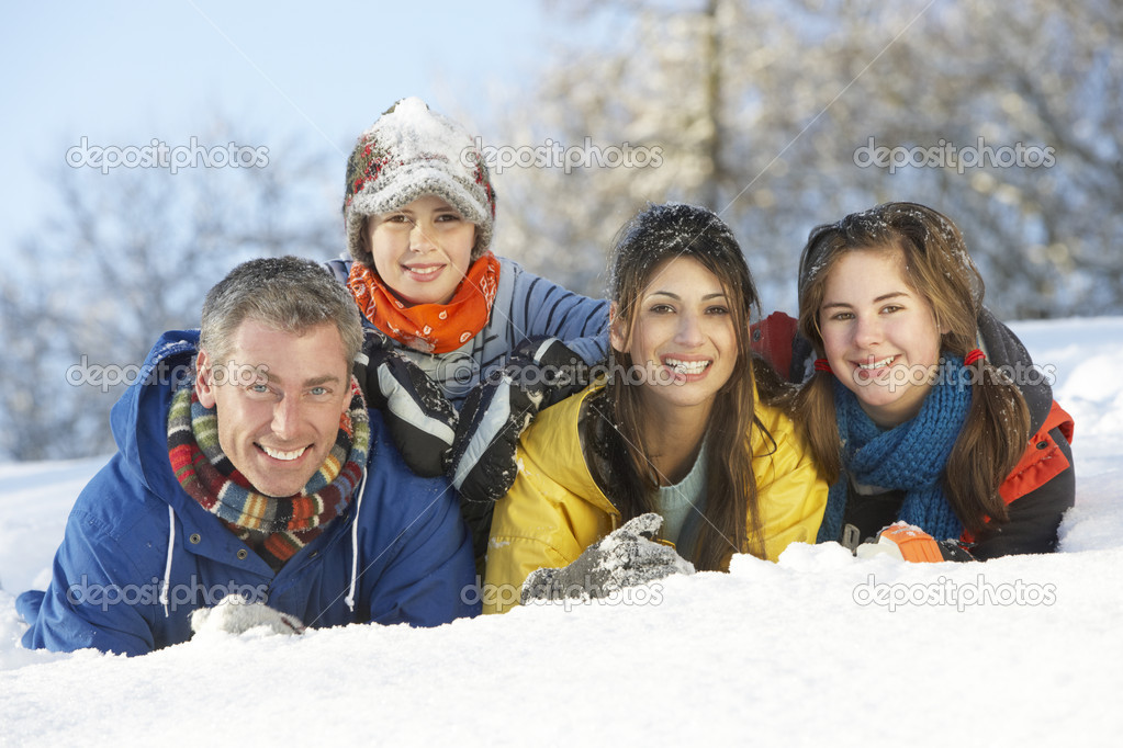 Young Family Having Fun In Snowy Landscape — Stock Photo #4837591