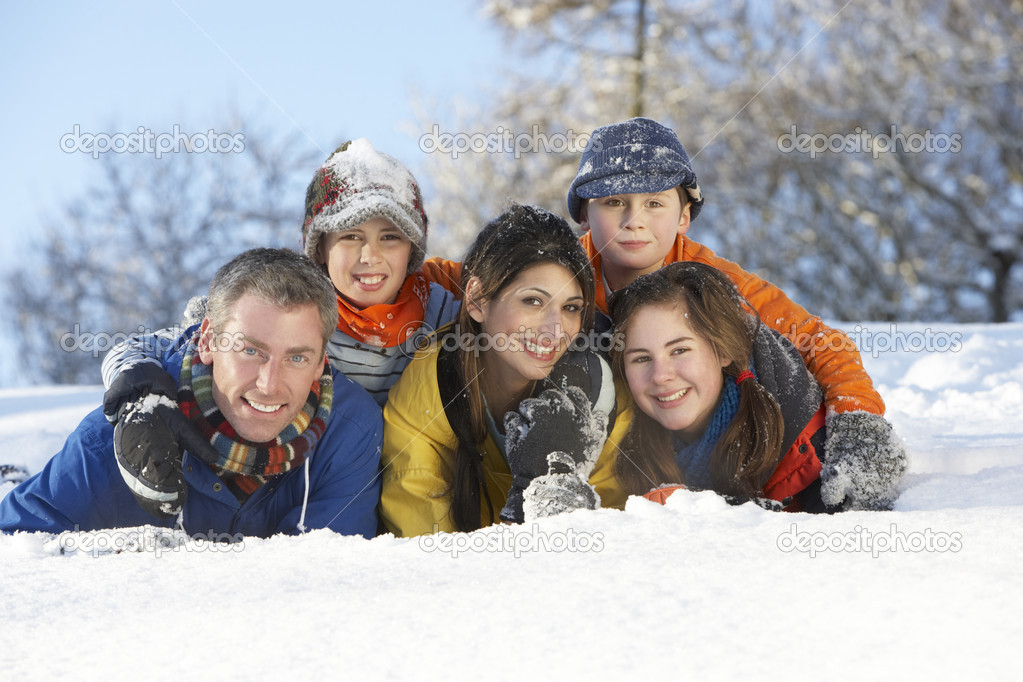 Young Family Having Fun In Snowy Landscape  Stock Photo #4837592