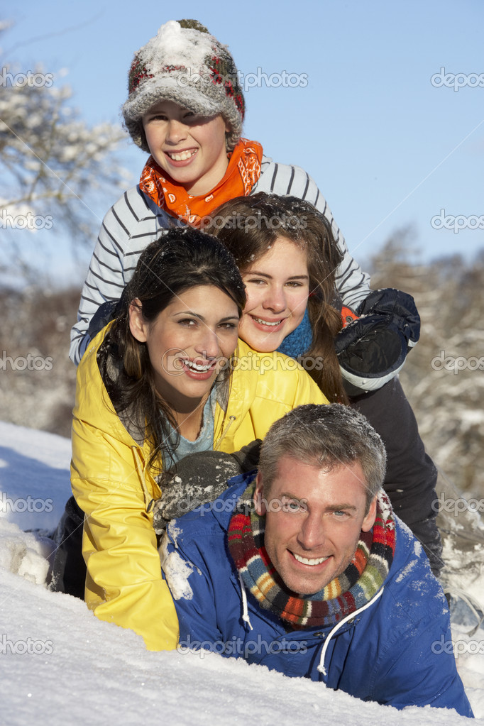 Young Family Having Fun In Snowy Landscape  Stock Photo #4837593