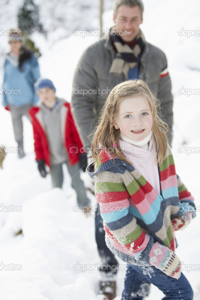 Family Enjoying Walk Through Snowy Landscape — Stock Photo #4837595
