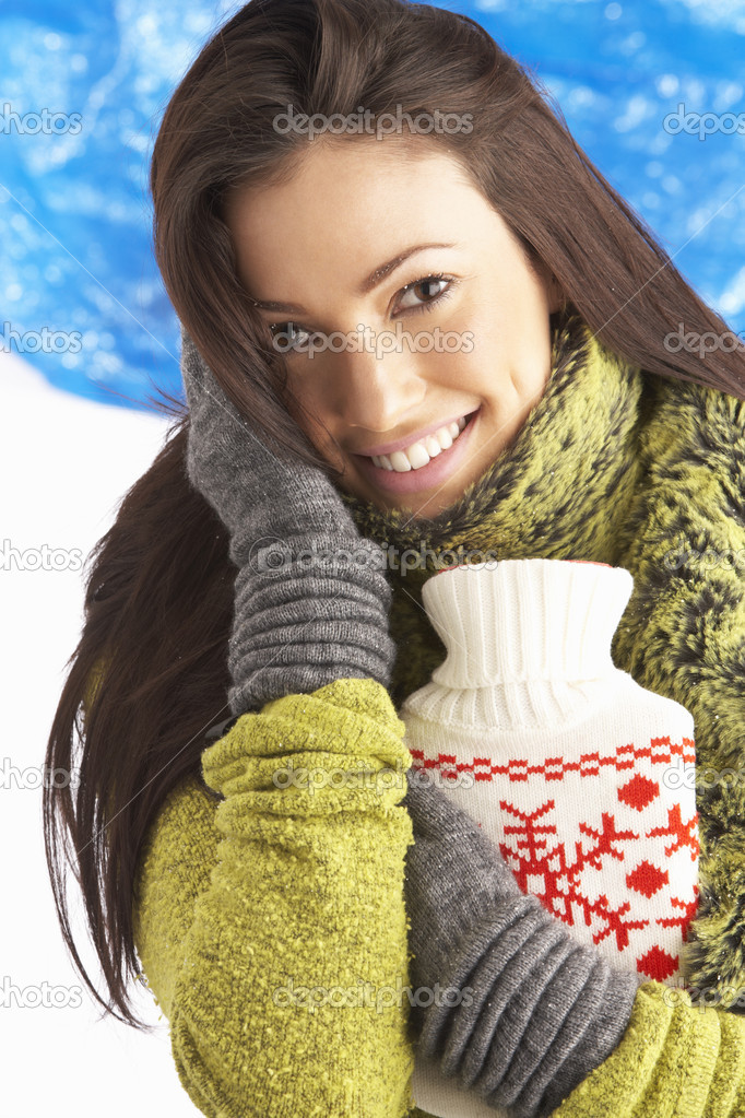 Young Woman Wearing Warm Winter Clothes Holding Hot Water Bottle — Stock Photo #4837804