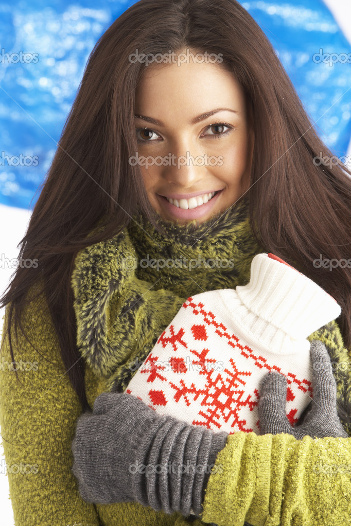 Young Woman Wearing Warm Winter Clothes Holding Hot Water Bottle — Stock Photo #4837806