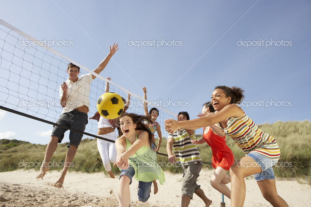 Group Of Teenage Friends Playing Volleyball On Beach — Stock Photo #4837848