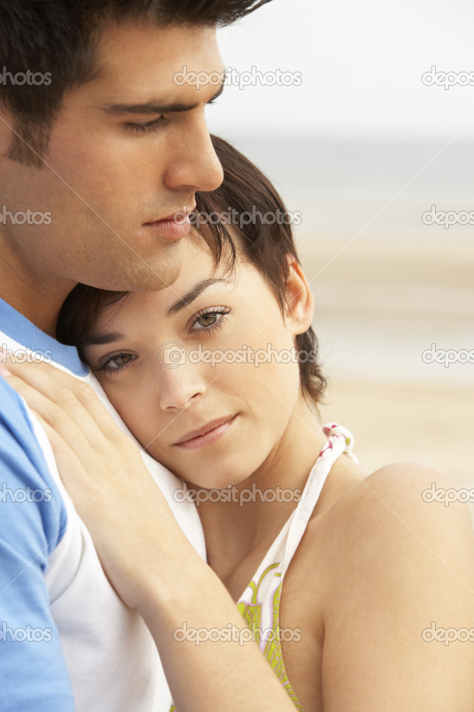 Romantic Young Couple Embracing On Beach  Stock Photo #4837945