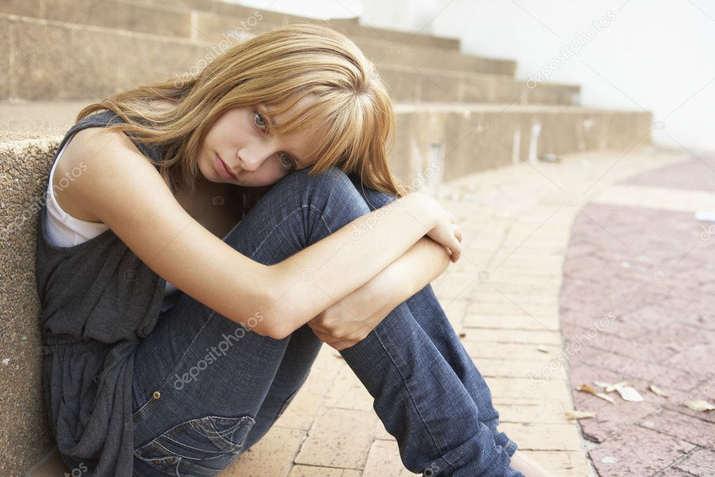 Unhappy Female Teenage Student Sitting Outside On College Steps — Stock Photo #4839025