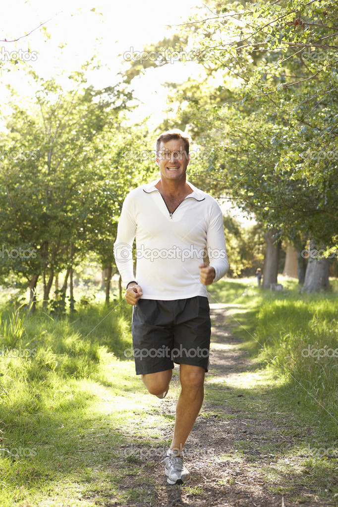 Middle Aged Man Jogging In Park — Stock Photo #4839396