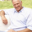 Middle Aged Man Relaxing In Garden — Stock Photo