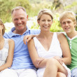 Family Relaxing In Garden — Stock Photo