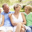 Family Relaxing In Garden — Stock Photo #4840130