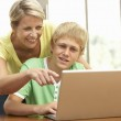 Mother And Teenage Son Using Laptop At Home — Stock Photo