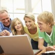 Family Using Laptop At Home — Stock Photo