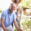 Father And Teenage Daughter Relaxing In Garden — Stock Photo